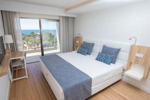Uma cama ou camas num quarto em Alfagar Aparthotel