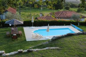 A view of the pool at Casa de Gandra or nearby
