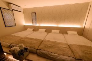 ゲストヴィラ箱根湯本101にあるベッド