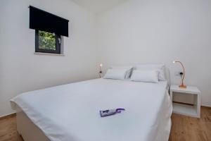 A bed or beds in a room at Villa David