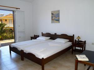 Ένα ή περισσότερα κρεβάτια σε δωμάτιο στο Sunny Flats