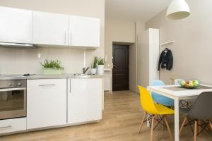 A kitchen or kitchenette at Sodispar Poselska Old Town Apartments
