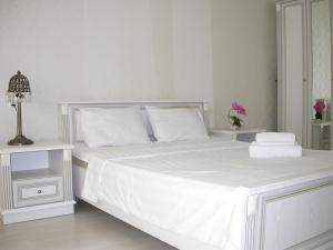 A bed or beds in a room at AHome 84 in Orbita district