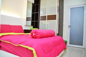 A bed or beds in a room at SPICE ARENA 3bed