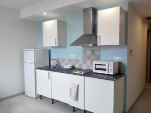 A kitchen or kitchenette at Comfort Calella
