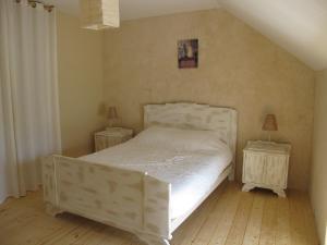 A bed or beds in a room at Dans l'Air du Temps
