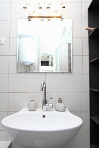 Kopalnica v nastanitvi Three-Bedroom Spacious Modern Apartment SS
