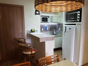 A kitchen or kitchenette at Flat Vista Azul em Pedra Azul - ES