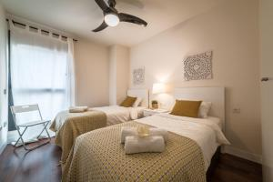 A bed or beds in a room at La Serna Premium Center