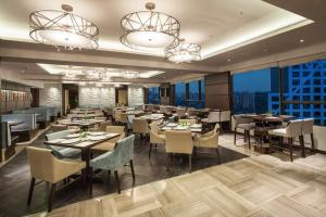 A restaurant or other place to eat at Ascott Raffles City Chengdu