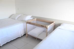 A bed or beds in a room at Nannai Flat Duplex Muro Alto