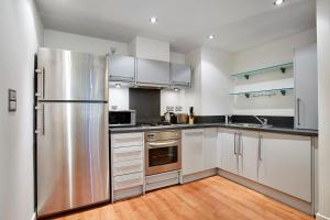 A kitchen or kitchenette at Riverbank Point By Flying Butler