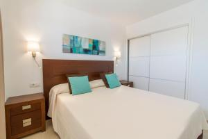 A bed or beds in a room at Torrent Bay by Intercorp Group