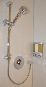 A bathroom at Zinn Apartments - The Royals