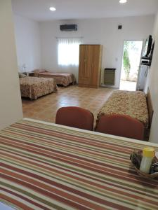 A bed or beds in a room at Apart Centro