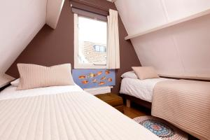 A bed or beds in a room at Holidayhome Amsterdam