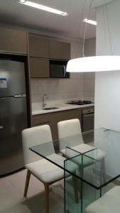 A kitchen or kitchenette at Beach Class Boa Viagem Prime