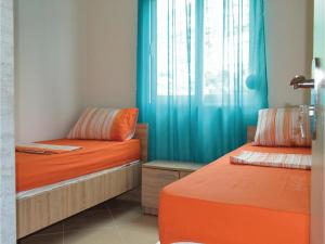 A bed or beds in a room at Apartment Sarande with Sea View 7