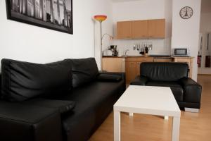 A seating area at Apartments City Room Berlin