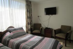 Cama o camas de una habitación en Suit Apart Estudio