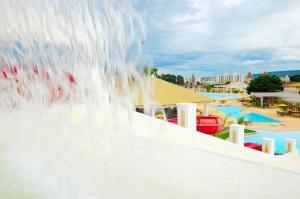 A view of the pool at Apartamentos Flat Lacqua - Caldas Tur or nearby