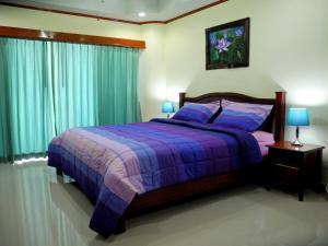 Кровать или кровати в номере Sky Orchid Beachfront