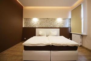 Ein Bett oder Betten in einem Zimmer der Unterkunft Apartments Röhrstraße