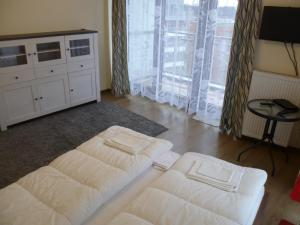 A bed or beds in a room at Energy Cell Apartments