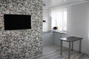Телевизор и/или развлекательный центр в Апартаменты на Володарского 27