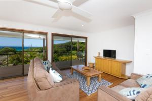 A seating area at The Beach House at One Mile - 6 Burrawong