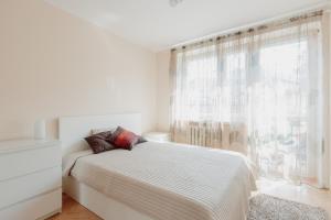Кровать или кровати в номере Apartment Vanilla Cracow