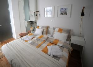 Posteľ alebo postele v izbe v ubytovaní Apartment Sunflower