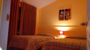 Cama o camas de una habitación en Munaycha Wasi I