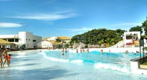 The swimming pool at or near Apartamentos Flat Lacqua - Caldas Tur
