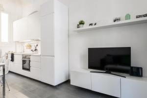 A television and/or entertainment center at Bergognone Apartment