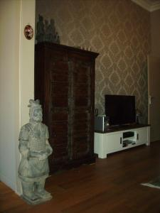 A television and/or entertainment center at Villa Apollo
