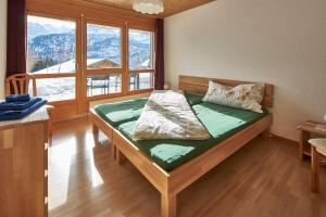 Ein Bett oder Betten in einem Zimmer der Unterkunft Ferienwohnung Leuweli