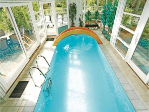 The swimming pool at or near Holiday home Trehøis-Åsen Gilleleje V