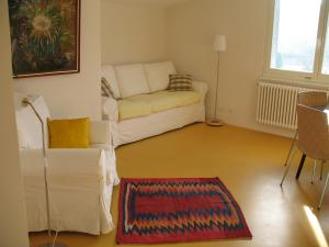 A bed or beds in a room at Appartement Les Iris