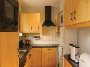 A kitchen or kitchenette at Three-Bedroom Holiday Home in Hoek