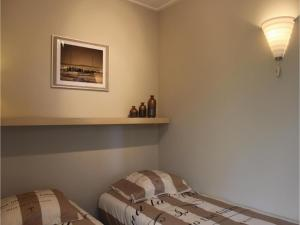 A bed or beds in a room at Three-Bedroom Holiday Home in Hoek