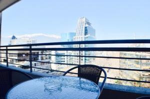 Un balcón o terraza de Apartamentos Premium Capital Lyon Costanera