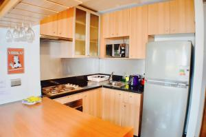 Una cocina o zona de cocina en Apartamentos Premium Capital Lyon Costanera