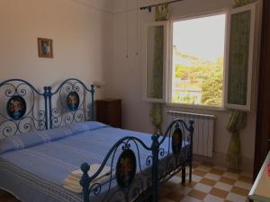 Letto o letti in una camera di Villa Maresole