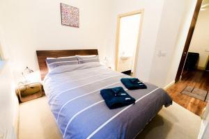Krevet ili kreveti u jedinici u okviru objekta Flinders Lane Superior Studio Apartment