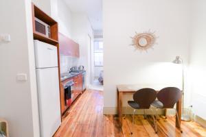 Kuhinja ili čajna kuhinja u objektu Flinders Lane Superior Studio Apartment