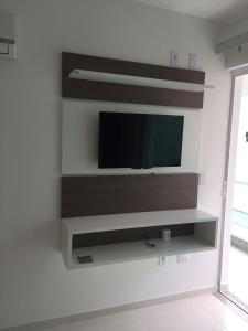 A television and/or entertainment center at Praia Grande