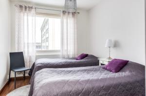 Vuode tai vuoteita majoituspaikassa Asuntohotelli Pohjantähti Apartment
