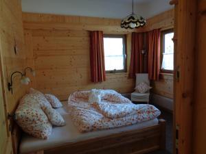 Ein Bett oder Betten in einem Zimmer der Unterkunft Drachenheim