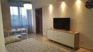 A television and/or entertainment center at Andrea's Apartments - Zanoli